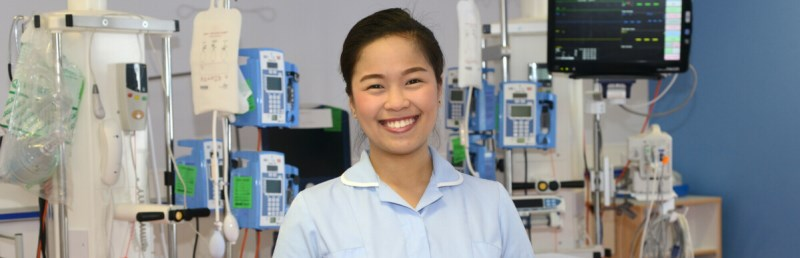 A nurse in ICU smiling