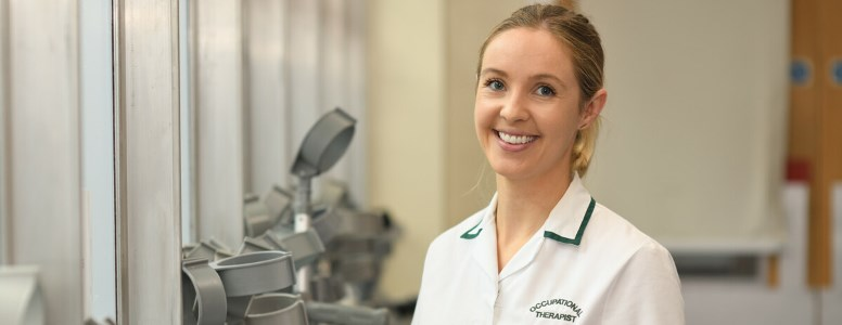 Occupational Therapist, Holly Kelsing, smiling at the camera