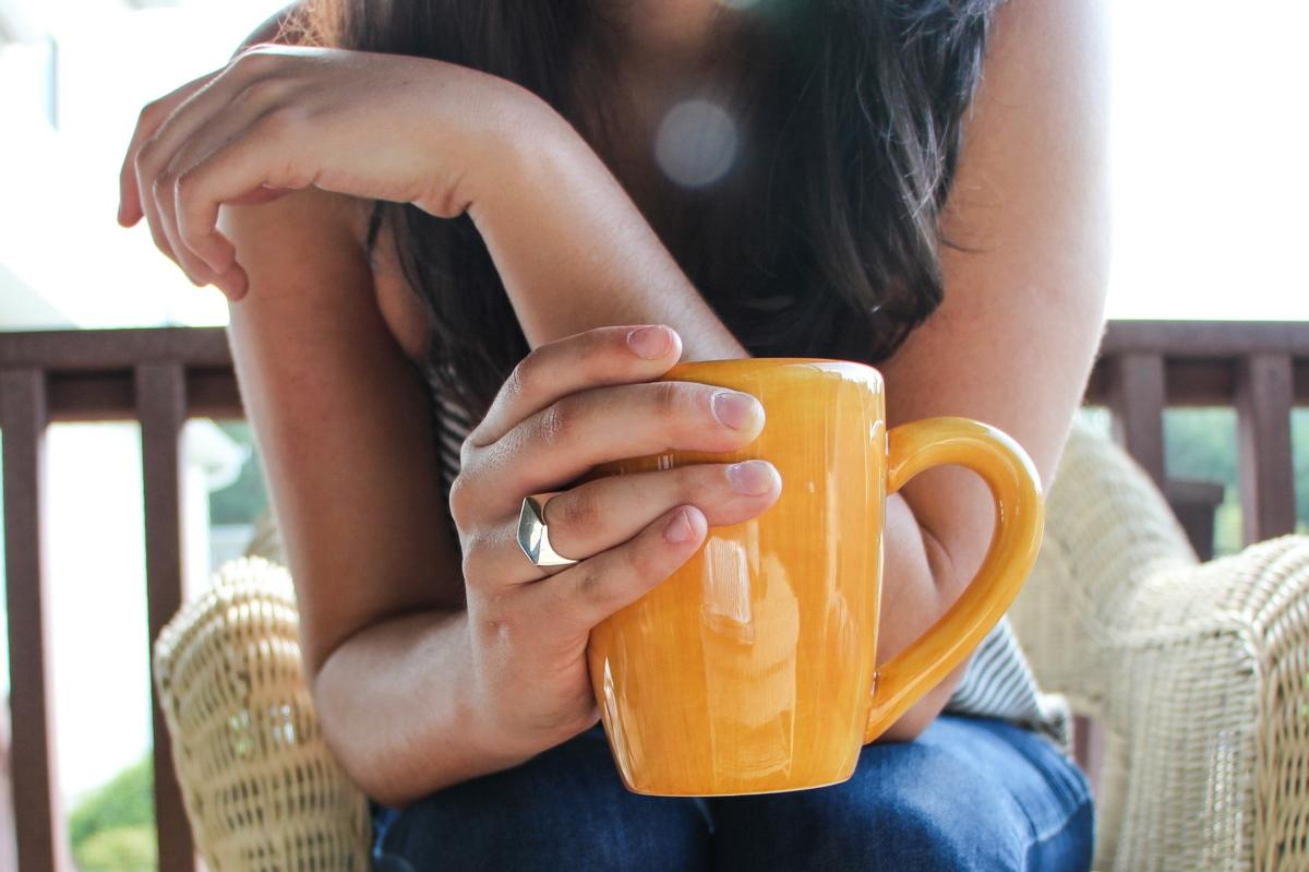 Image of women holding cup