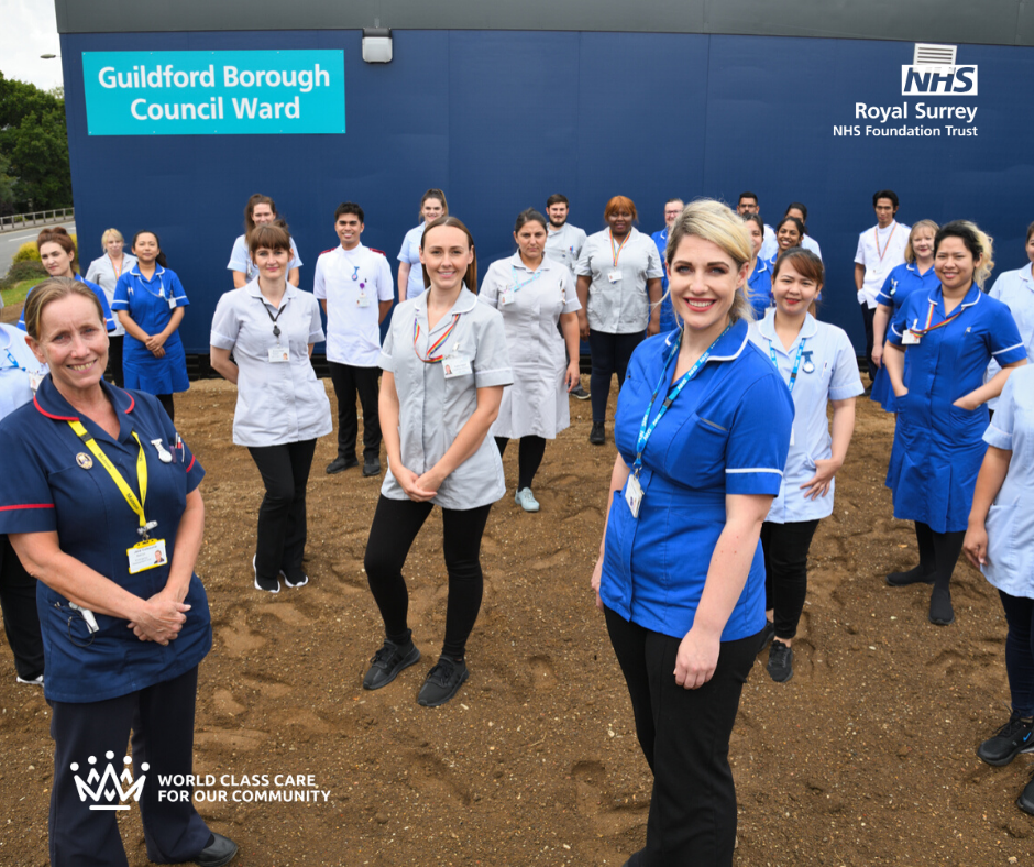 Pic of Guildford Team posing outside the ward