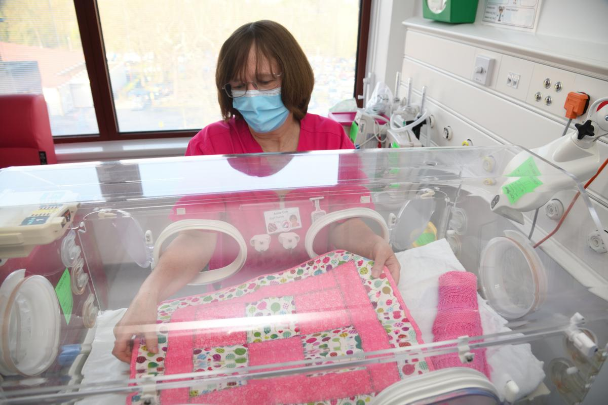 Nurse working at a Baby incubator