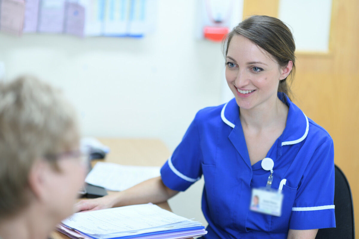 Chemotherapy nurse talking to a patient