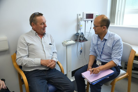 Oncology consultant talking to a patient