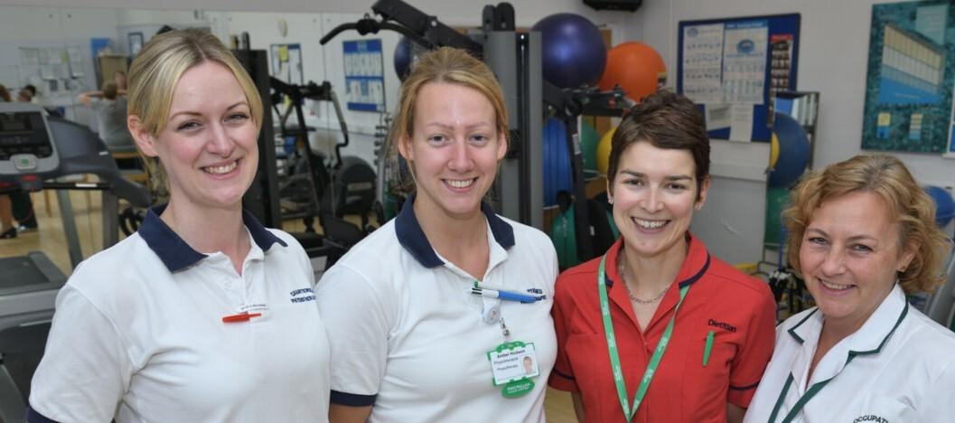 Four physiotherapists, smiling