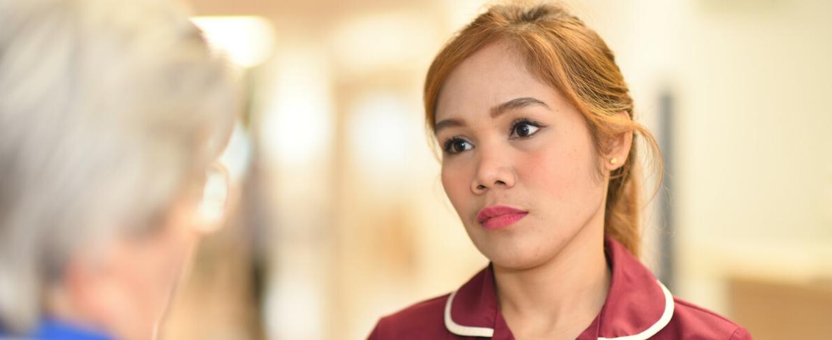 Chief nurse listening to a patient