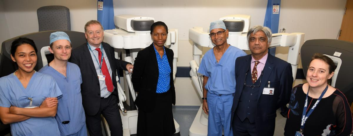 Surgery team in front of new robots