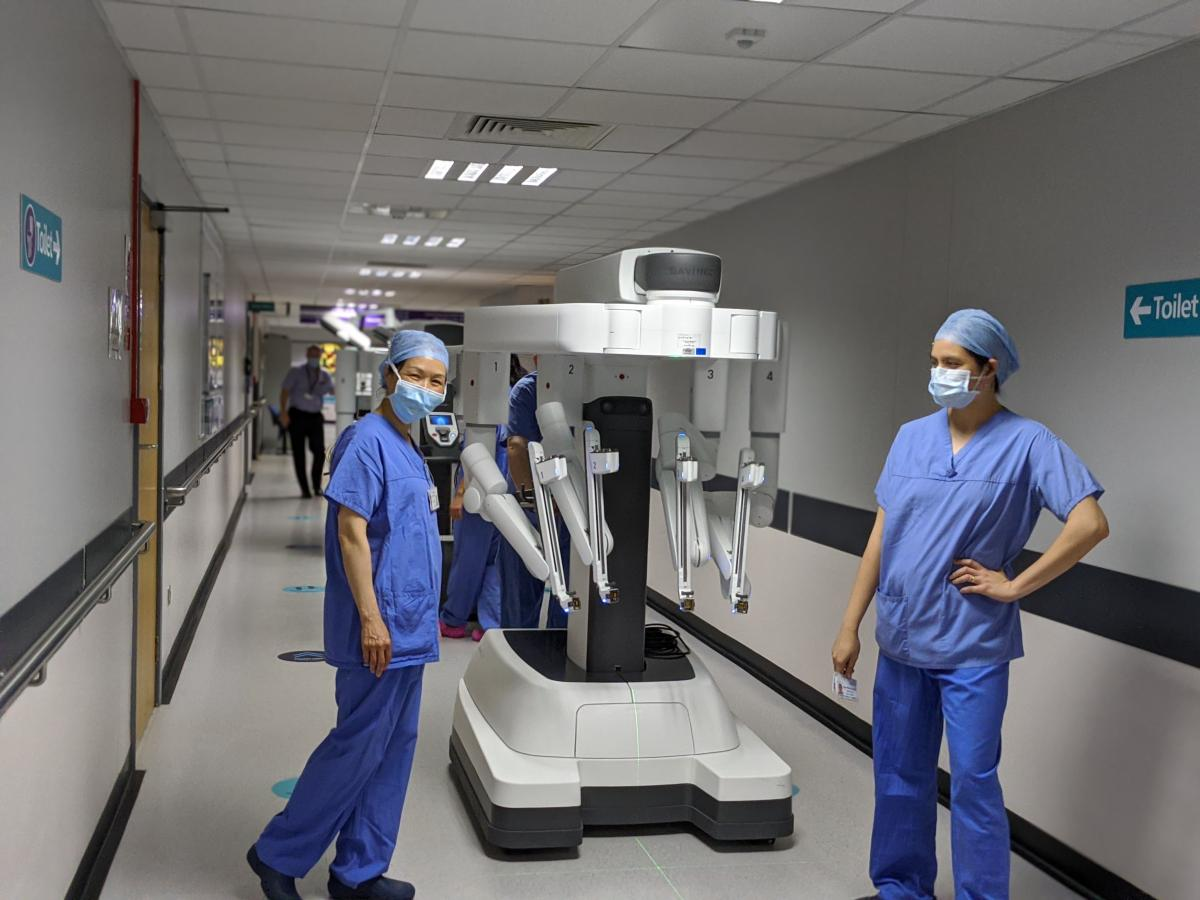 Surgery staff posing with surgical robot
