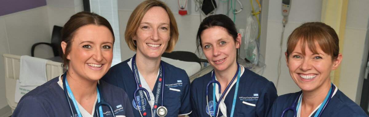 Four nurses smiling pic